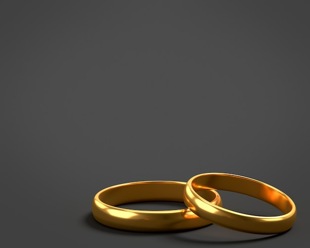 Twee gouden trouwringen liggen op elkaar met lege ruimte voor tekst