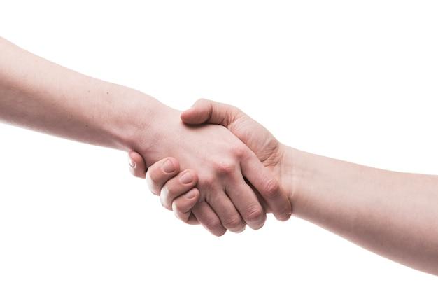 Twee handen in handdruk