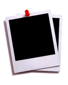 Twee instant foto afdrukken met pushpin
