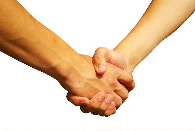 Twee jonge zakenlieden die handen schudden