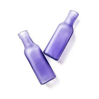 Twee lila glazen lege flessen handgemaakte vazen groep objecten geïsoleerd op een witte achtergrond