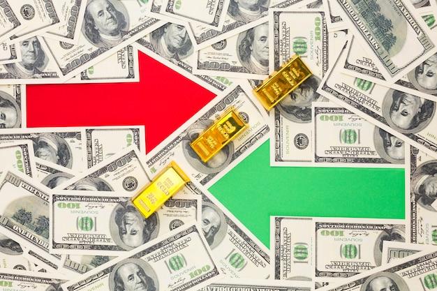 Twee pijlen bovenop bankbiljettenachtergrond
