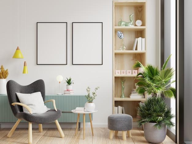 Twee postermodel met verticale frames op lege witte muur in woonkamerinterieur en fauteuil.3d-rendering