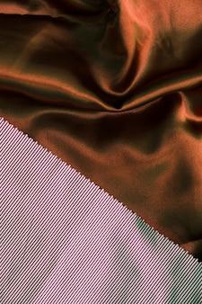 Twee verschillend type bruine stoffenachtergrond