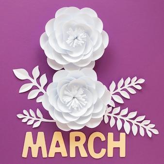 Twee witte papieren bloemen voor vrouwendag met maand