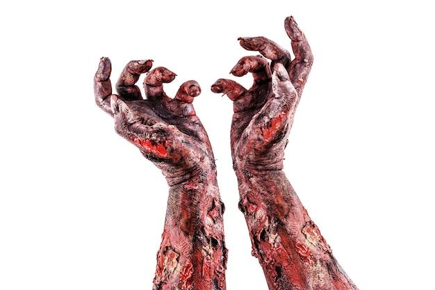 Twee zombiehanden die opstaan, geïsoleerd wit oppervlak, halloween-thema.