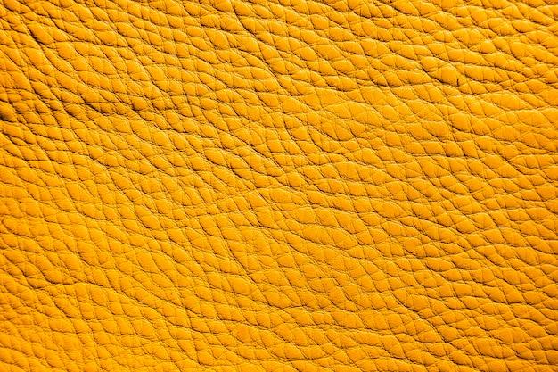 Uiterst close-up gele lederen textuur achtergrond oppervlak