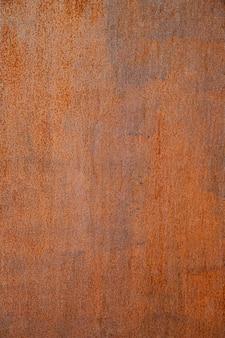 Uiterst close-up roestige bruine ijzeren muur