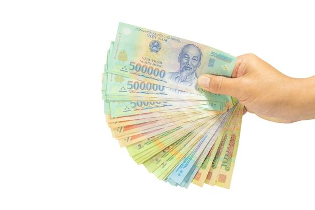 Uitknippad geld in vietnam bij de hand