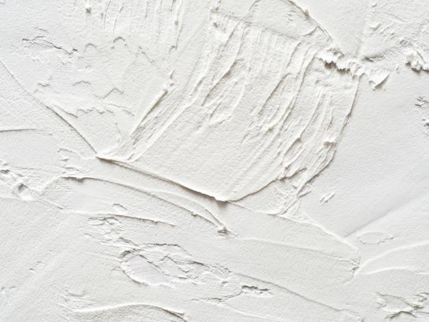 Uitstekend of grungy wit van natuurlijke cement of steen oude textuur als retro patroonlay-out.