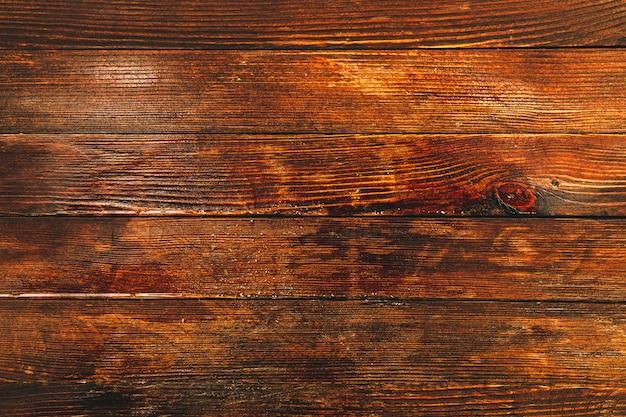 Uitstekende bruine houten textuur als achtergrond met knopen en spijkergaten