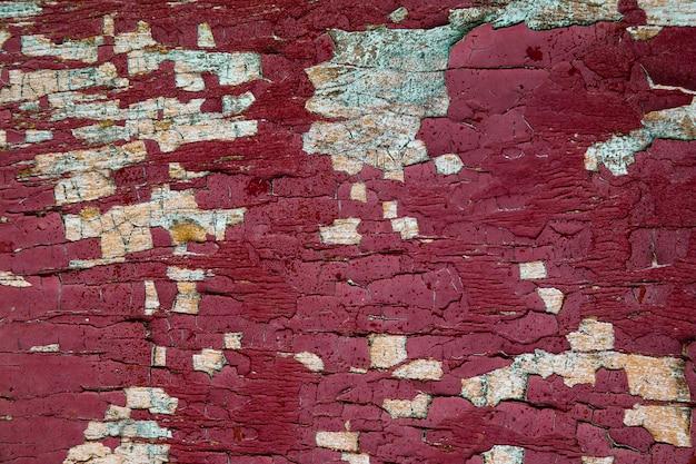 Uitstekende close-up als achtergrond, exemplaarruimte. rode geschilderde houten achtergrond. houten structuur