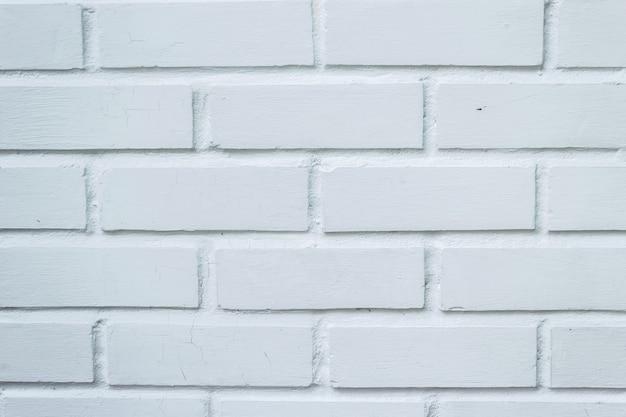 Uitstekende de textuurachtergrond van de bakstenen muur schone witte kleur.
