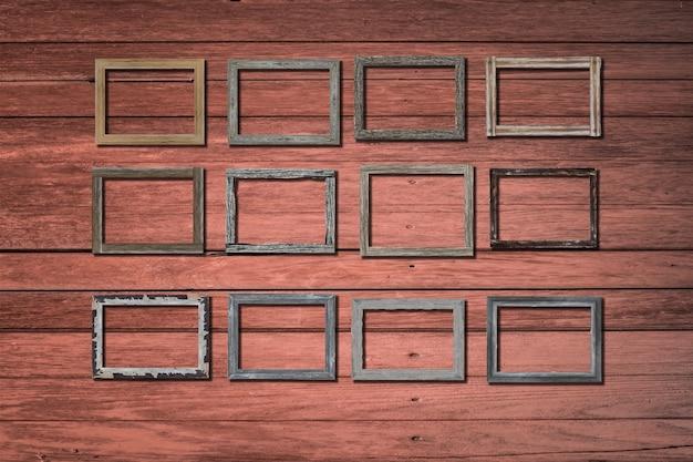 Uitstekende fotoframes op houten muur voor binnenland of achtergrond.