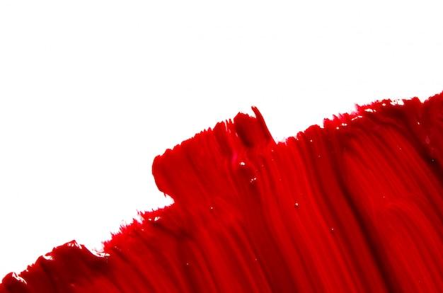 Uitstrijkje en textuur van rode lippenstift of acrylverf achtergrond.