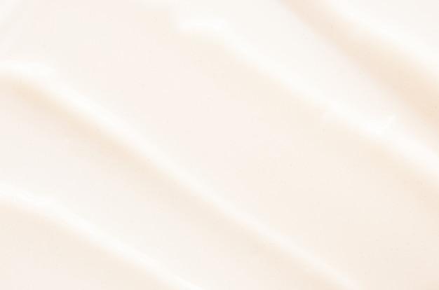 Uitstrijkjes en textuur van gezichtscrème huidverzorging concept afbeelding