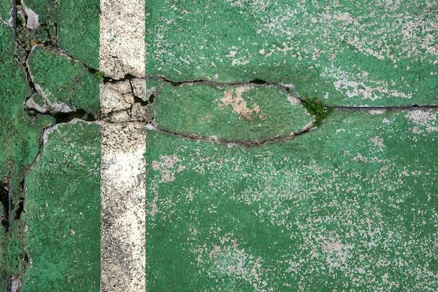 Uitzicht op groene textuur met een witte streep met kopie ruimte.