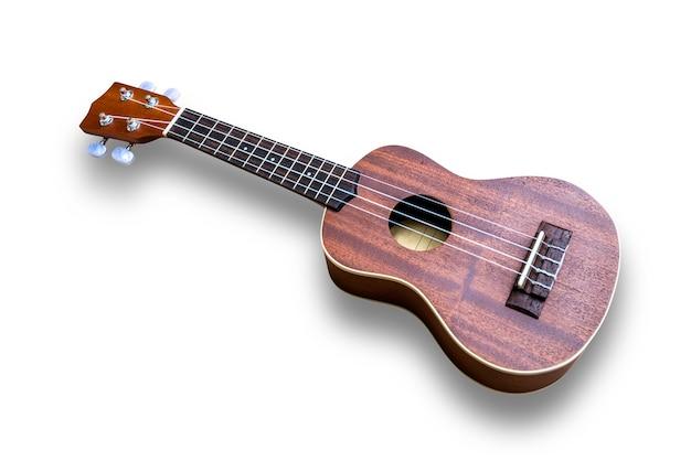 Ukelele hawaiiaanse gitaar die op witte achtergrond wordt geïsoleerd