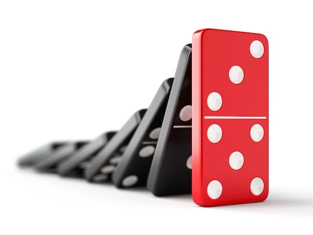 Unieke rode dominosteen stopt vallende zwarte dominostenen. leiderschap, teamwork en bedrijfsstrategie concept.