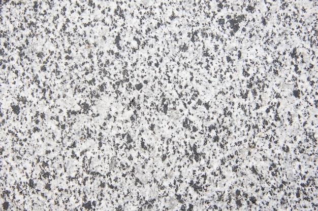 Uniforme tegel, granieten vloertextuur, graniet. lichte ondergrond gemaakt van natuursteen.