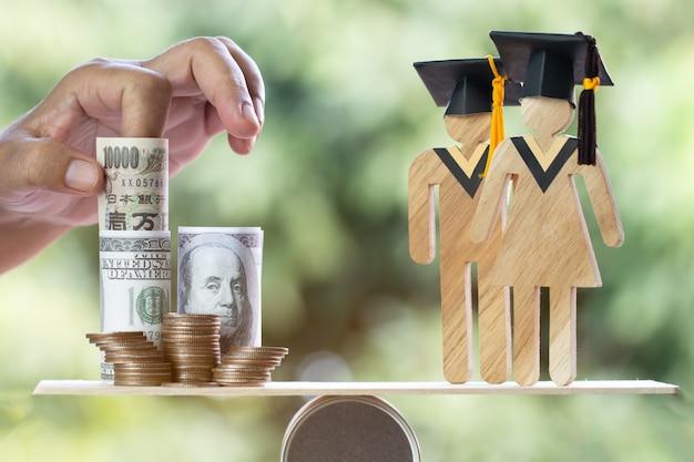 Universitair onderwijs leren in het buitenland internationaal idee. afstuderen van studenten bespaart munten us dollar, jpy