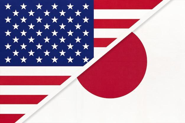 Usa vs japan nationale vlag van textiel. relatie tussen twee amerikaanse en aziatische landen.