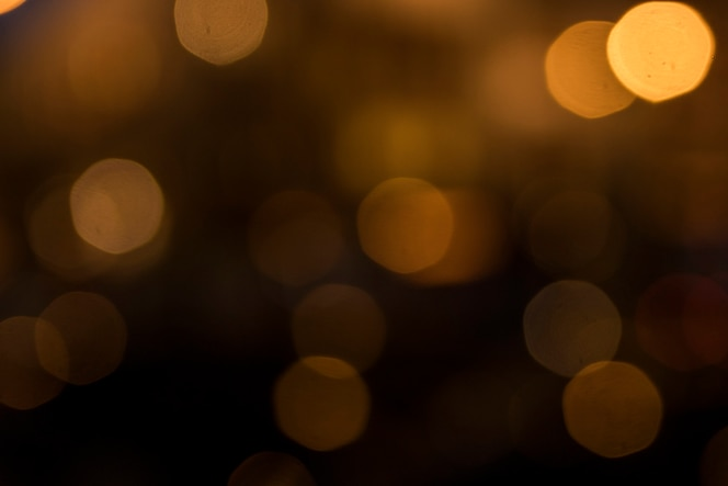 Vage bokeh lichten op donkere achtergrond