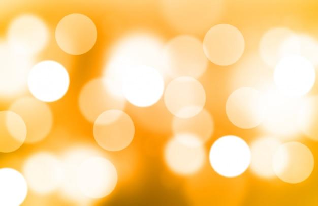 Vage lichtgele of gouden gradiënt bokeh abstracte achtergrond