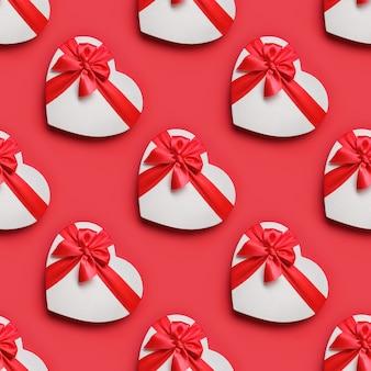Valentijnsdag naadloze patroon van witte hart dozen op rood