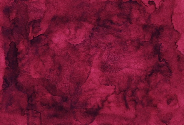 Van achtergrond waterverfbourgondië geschilderd textuurhand. vintage aquarel diepe karmozijnrode achtergrond. vlekken op papier.