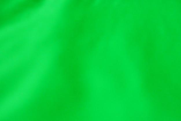 Van de het onduidelijke beeldnadruk van de close-up groene doek de textuur als achtergrond