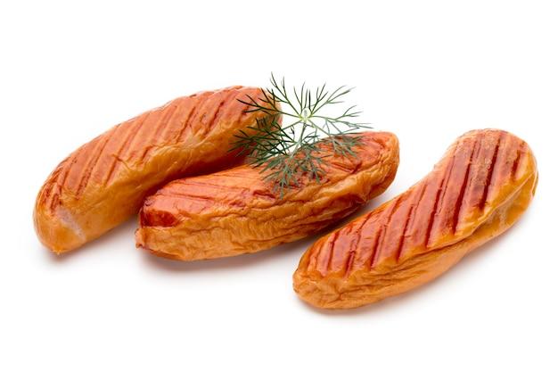 Varkensvleesworst en kruiden op wit wordt geïsoleerd dat.