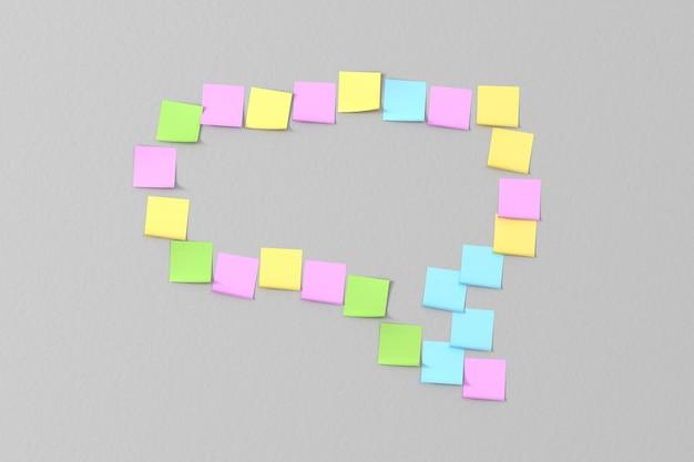 Veel gekleurde stickers geplakt op de grijze muur in de vorm van berichten uit het bericht