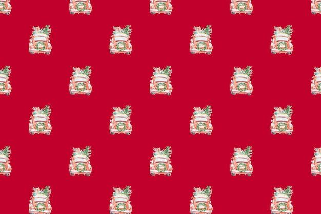 Veel kerstspeelgoedauto's op een rode achtergrond