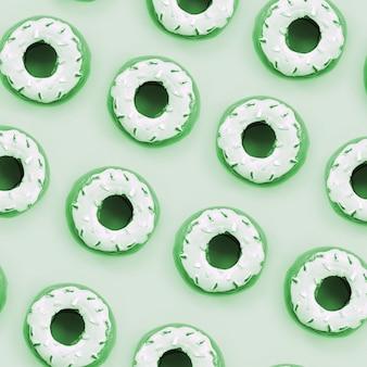 Veel kleine plastic donuts ligt op een pastel kleurrijke achtergrond