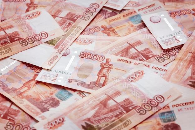 Veel roebelrekeningen als een full-frame achtergrond