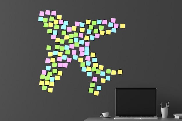 Veel stickers geplakt op een donkergrijze muur in de vorm van een vliegend vliegtuig