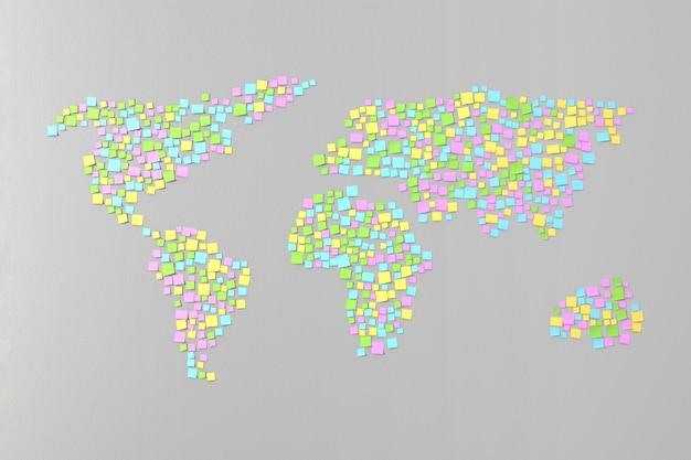 Veel stickers op de muur geplakt in de vorm van silhouetten van continenten