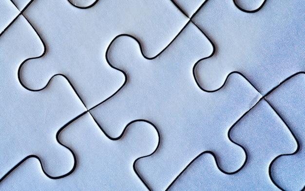 Verbonden stukjes blauwe puzzel close-up teamwork concept