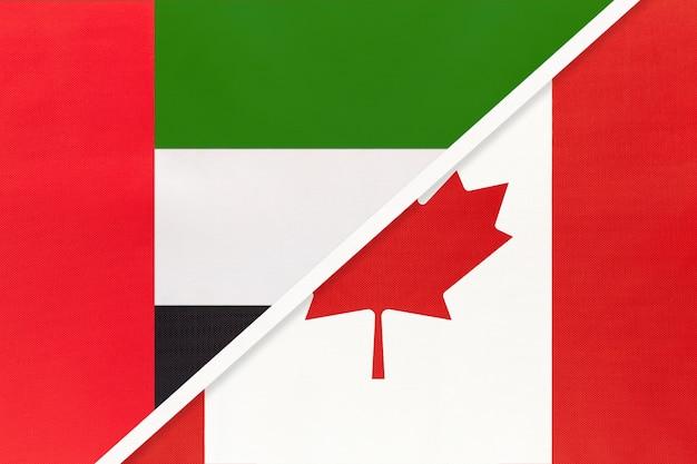 Verenigde arabische emiraten of vae en canada, symbool van twee nationale vlaggen van textiel.
