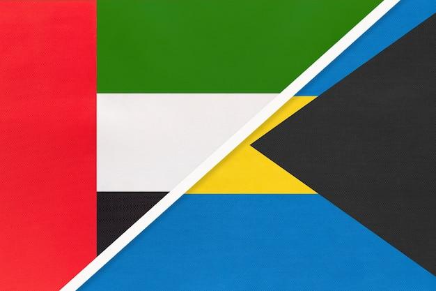 Verenigde arabische emiraten of vae en de bahama's, symbool van twee nationale vlaggen van textiel.