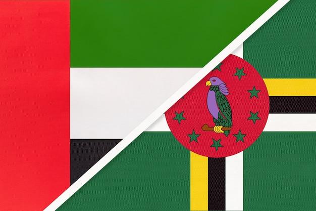 Verenigde arabische emiraten of vae en dominica, symbool van twee nationale vlaggen van textiel.
