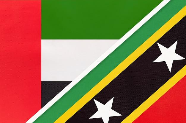 Verenigde arabische emiraten of vae en saint kitts en nevis, symbool van twee nationale vlaggen van textiel.