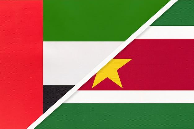 Verenigde arabische emiraten of vae en suriname, symbool van twee nationale vlaggen van textiel.