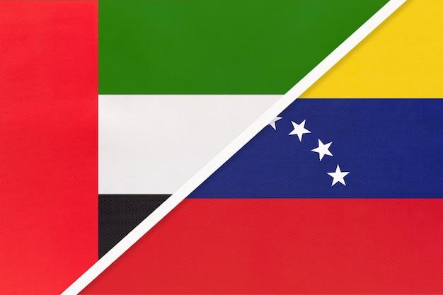 Verenigde arabische emiraten of vae en venezuela, symbool van twee nationale vlaggen van textiel.