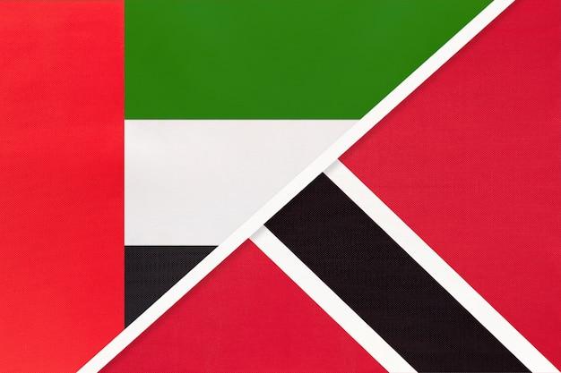 Verenigde arabische emiraten of verenigde arabische emiraten en trinidad en tobago, symbool van twee nationale vlaggen van textiel.