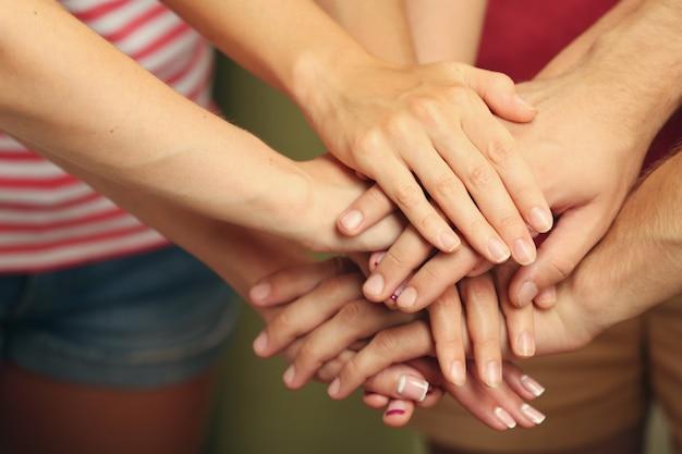 Verenigde handen close-up