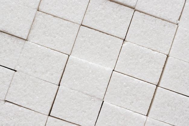 Verfijnde suikeroppervlakte, close-up, achtergrondtextuur