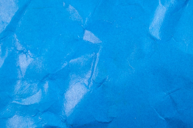 Verfrommeld blauw papier achtergrond.
