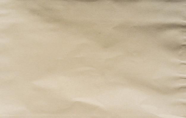 Verfrommeld bruin en bruin gekleurd papier horizontale achtergrondstructuur